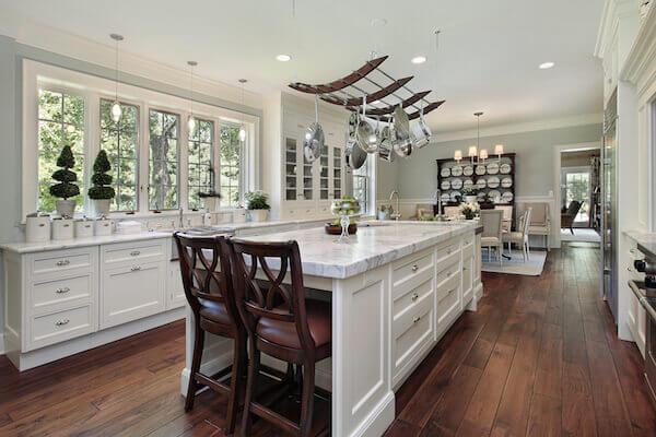 Bigstock- 38333398 - Kitchen in luxury home with white granite island