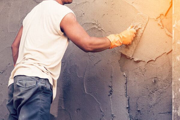 bigstock-Man-Plasterer-Concrete-Working-119022161